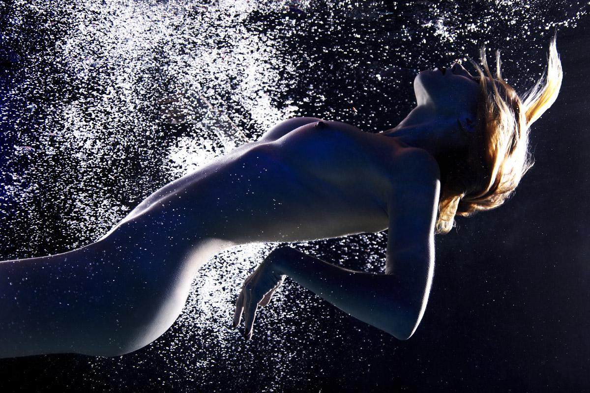 Topless girls swimming underwater