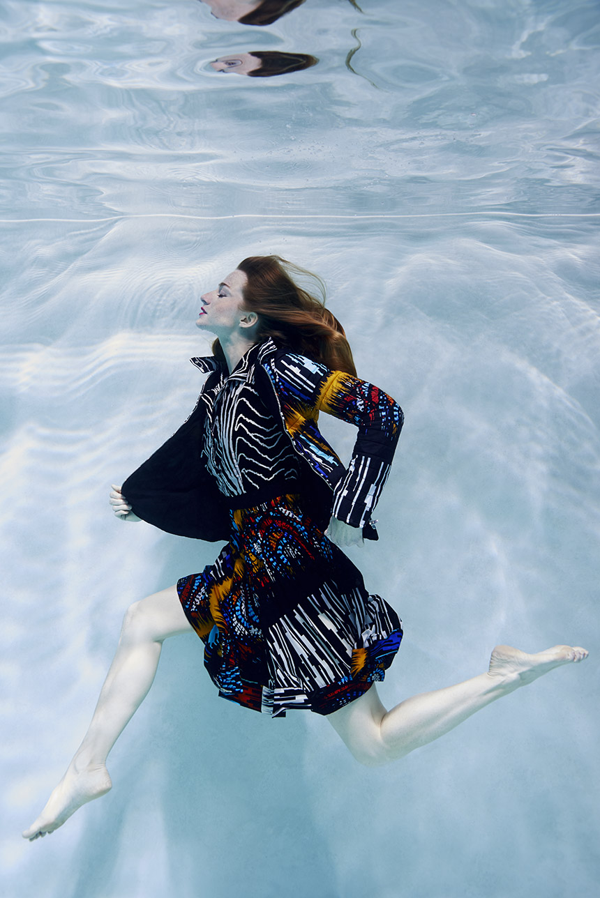 fashion model running underwater